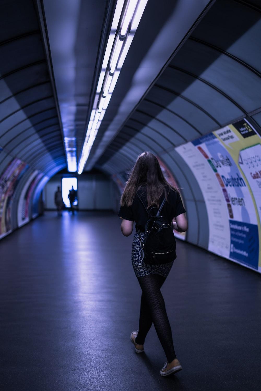 woman walking on tunnel