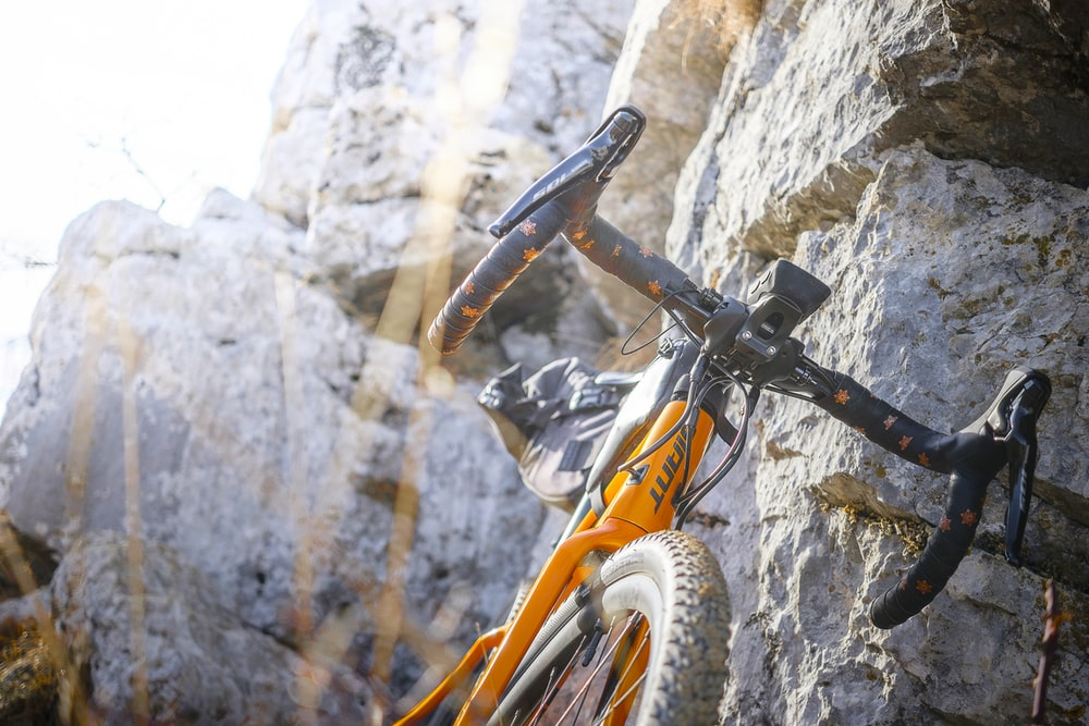 bicycle leaning on rock formation