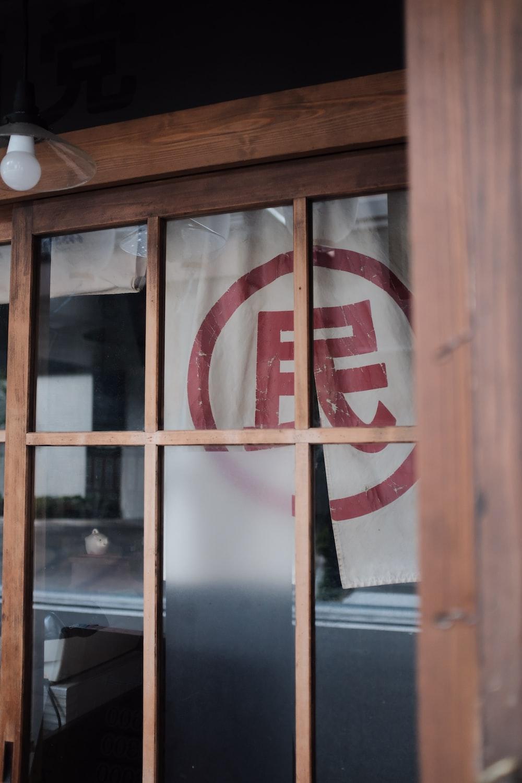 brown wooden framed glass panel window