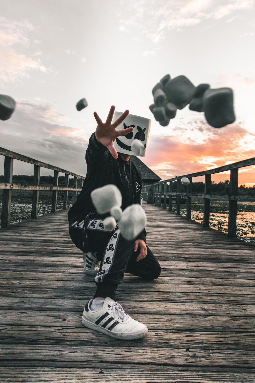 man wearing Marshmellow mask