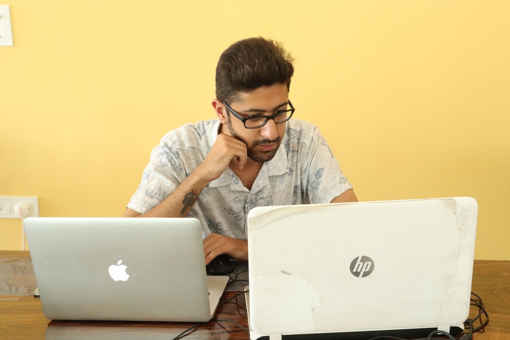 man looking at laptop computer