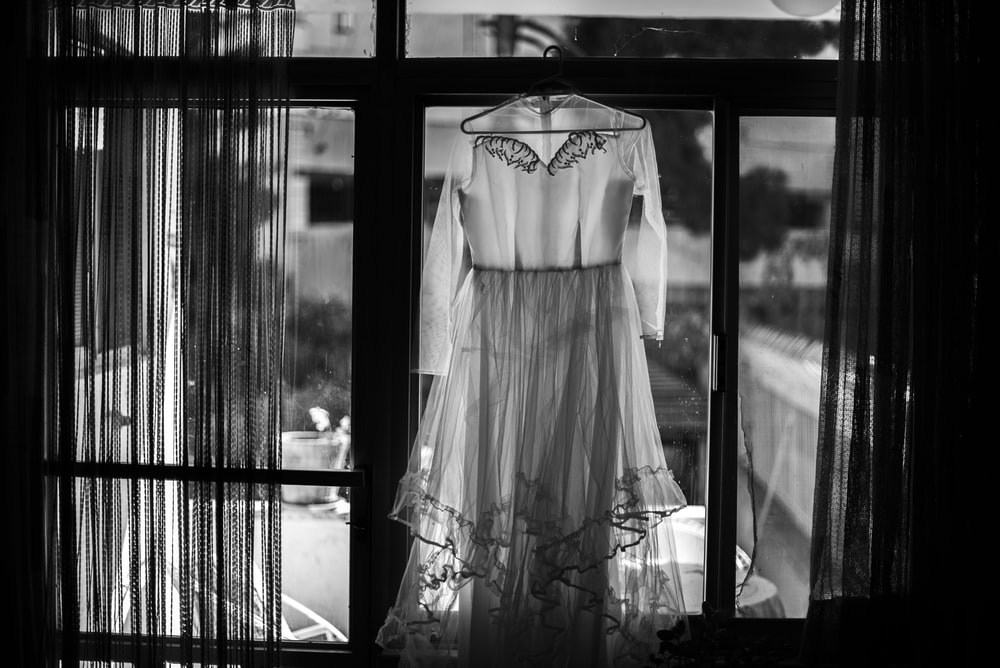 grayscale photography of dress hanging
