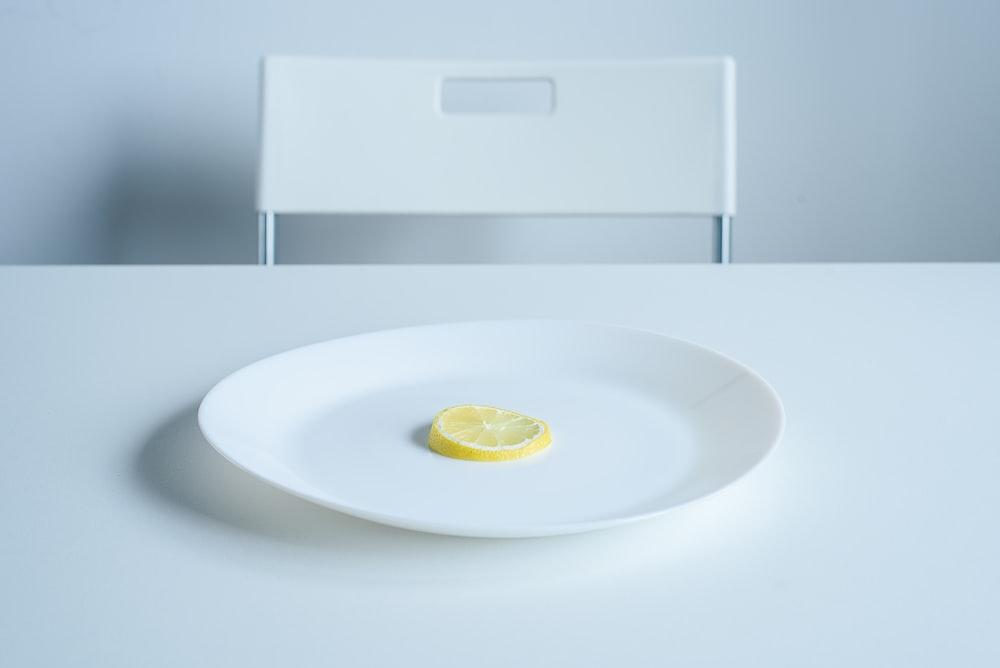 lemon sliced on round white ceramic plate