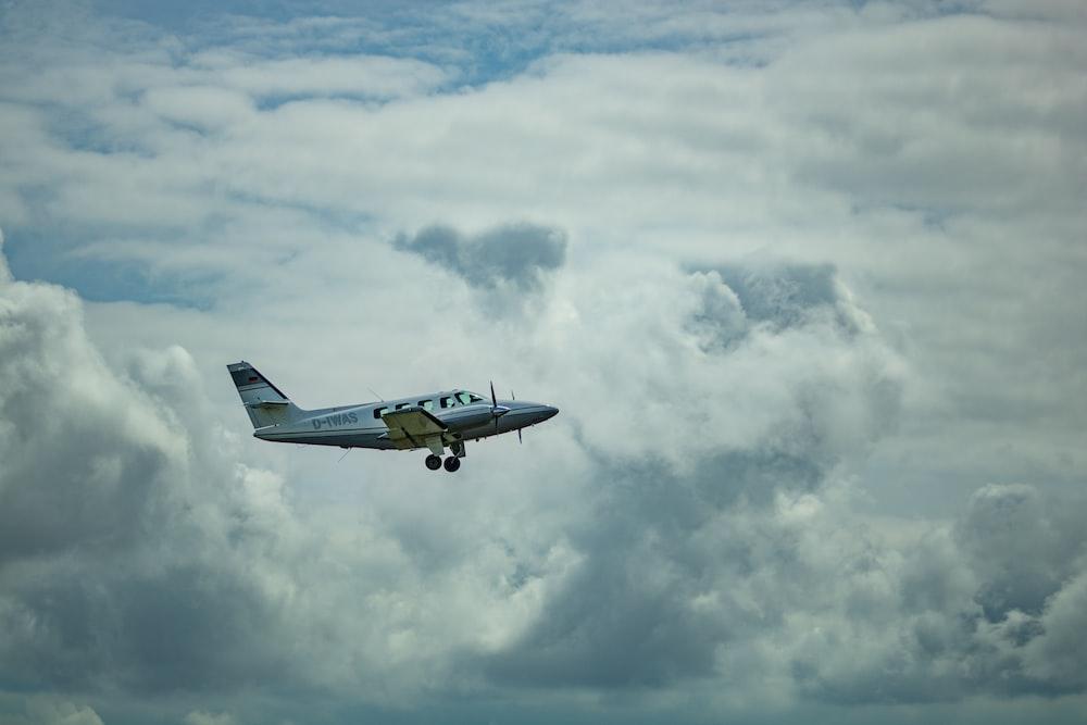 white airplane midair scenery