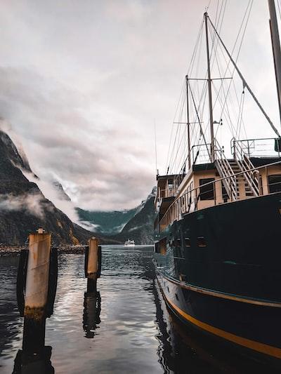 black and yellow ship at a dock