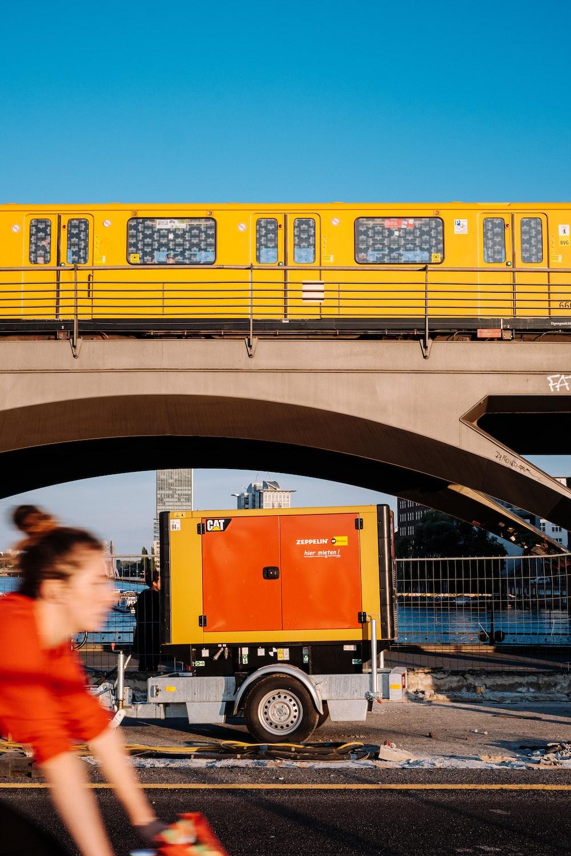 trailer under yellow train