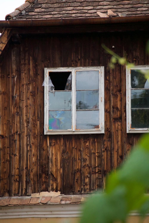 broken square white framed glass window