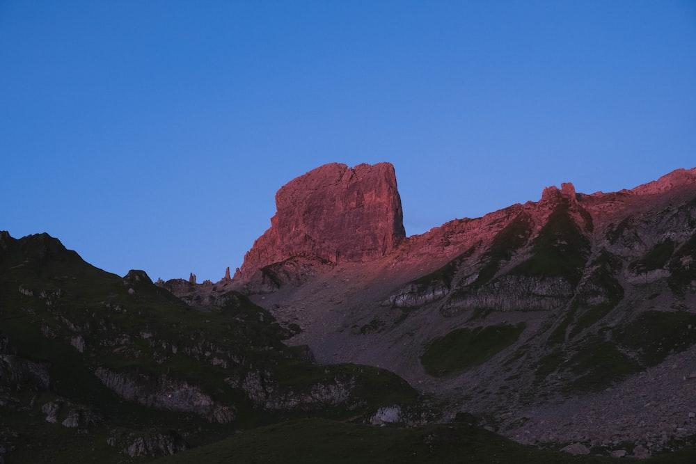 rocky valley under blue sky