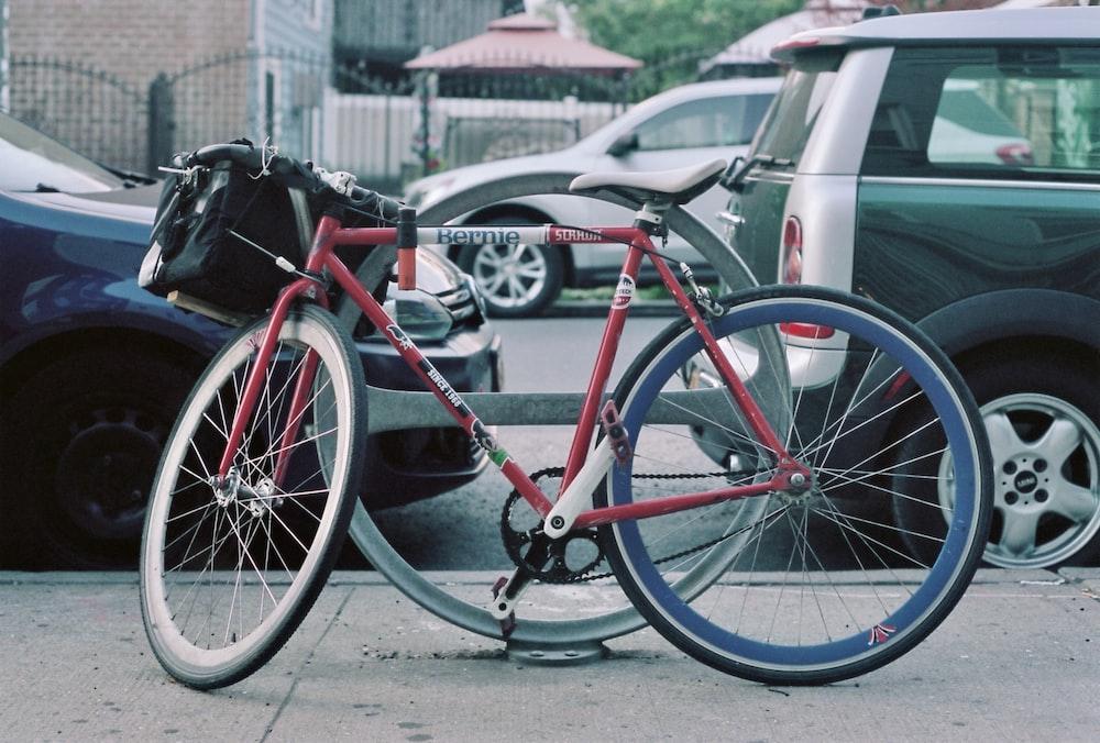 red bike beside road