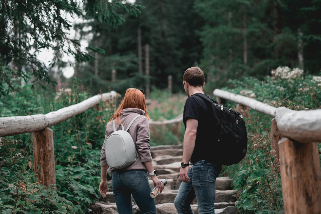Close-Up Photography of Couple Walking Up On Stairs - unsplash
