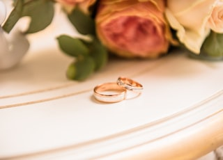 two couple rings on table