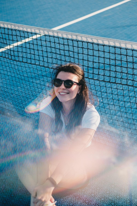 woman wears black frame sunglasses