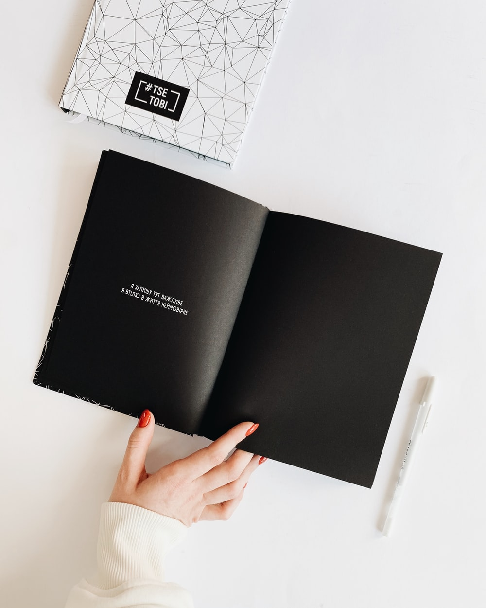 black book on white surface
