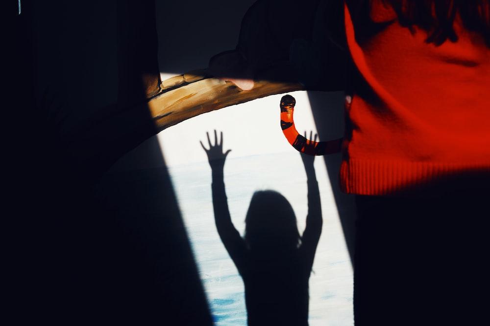 silhouette of children raising hand