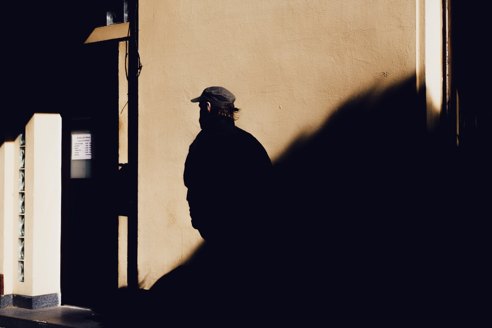 silhouette of man walking painting