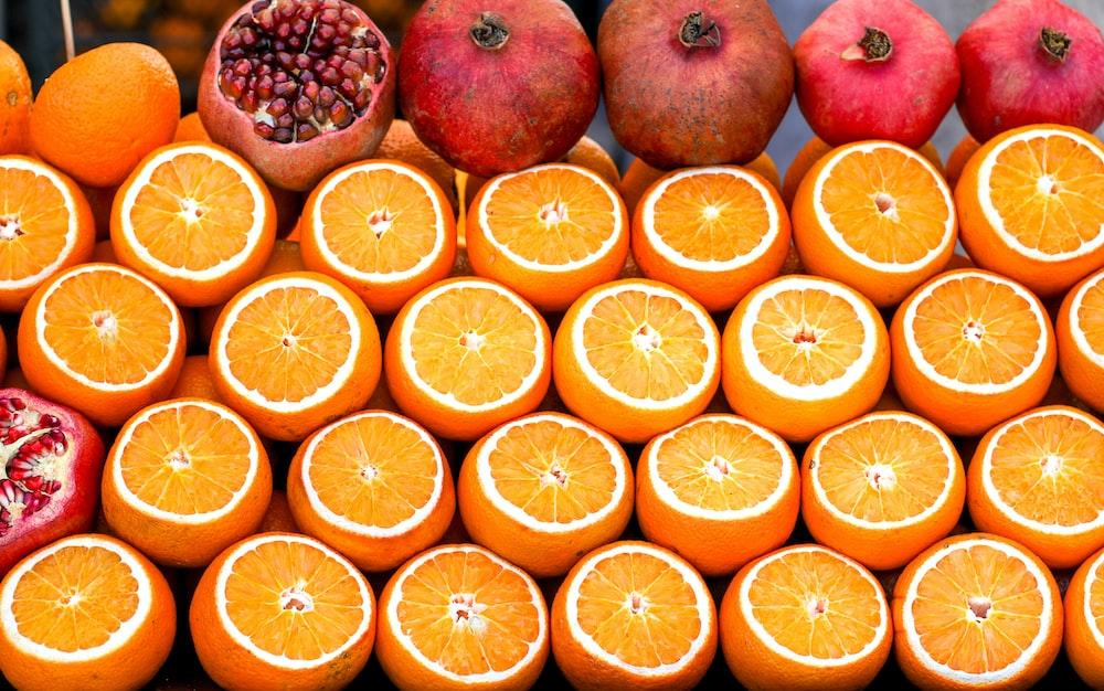 pomegranate fruits near orange fruits