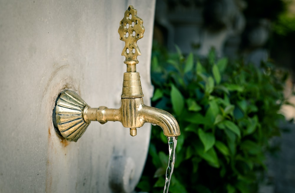 gold-colored faucet