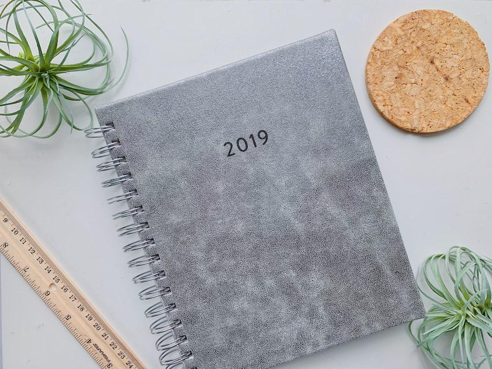 2019 notebook beside ruler on table