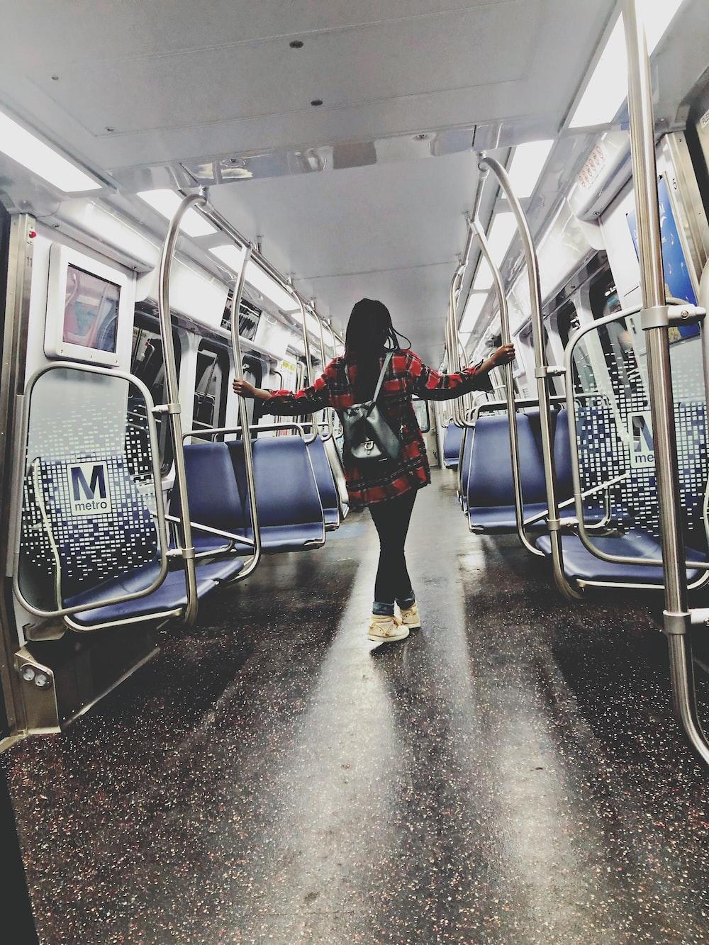 woman standing inside train