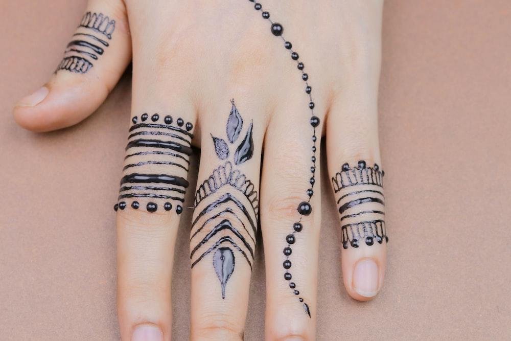 hand tattoo mehndi design
