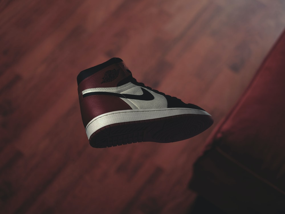 white and red Air Jordan 1 sneaker