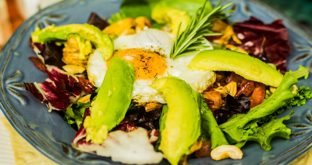 plate of vegetable salad and sunny side up egg