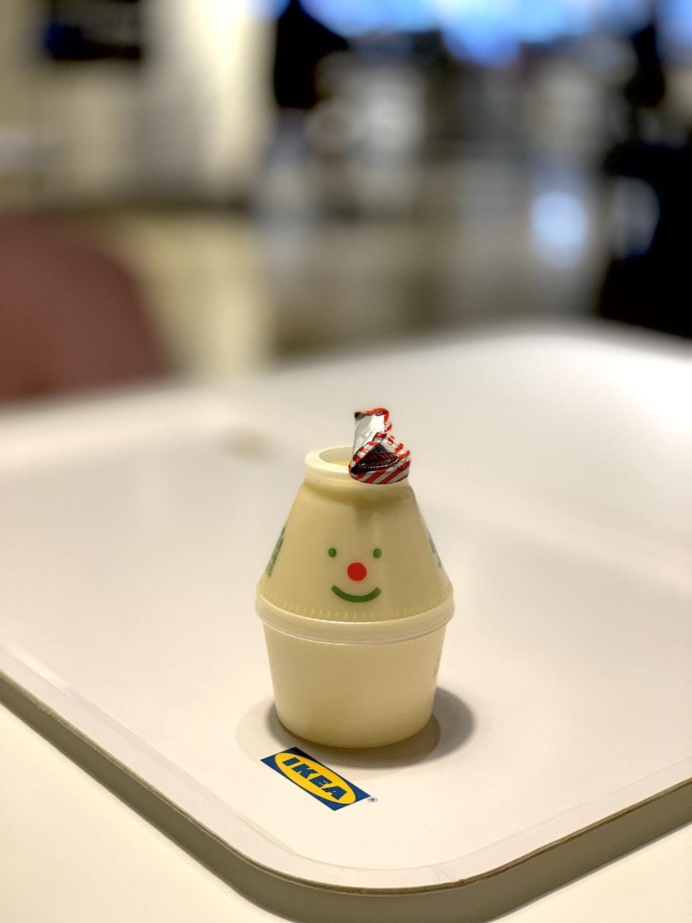 white plastic cone toy on white IKEA tray