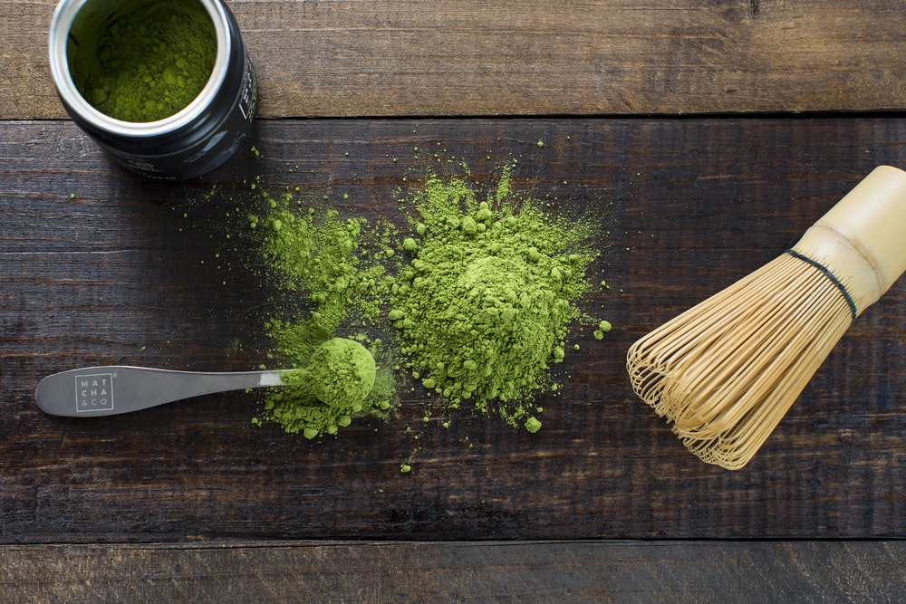 green powder and spoon on board