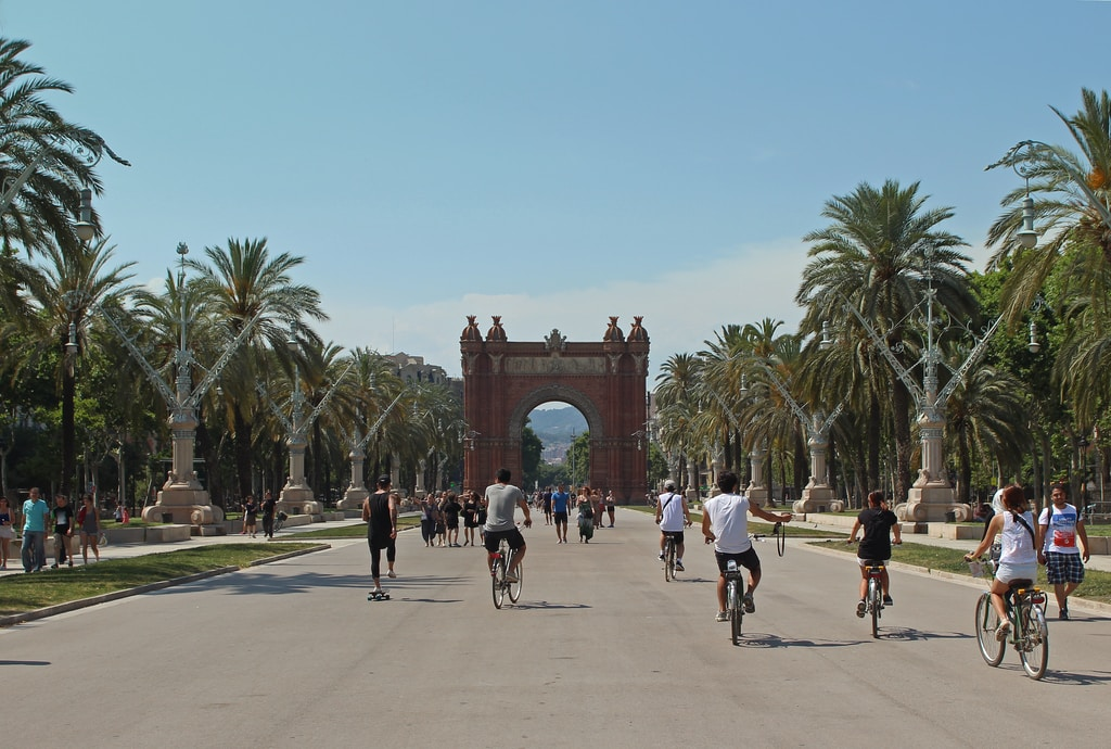 people running and riding bicycles on cement
