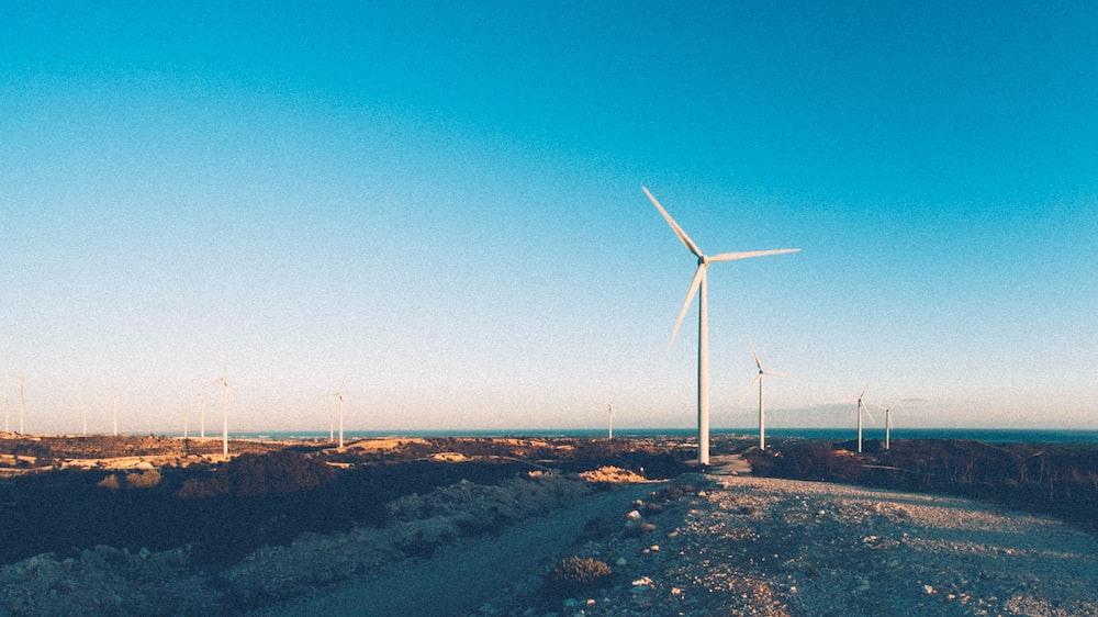 wind turbines under clear sky