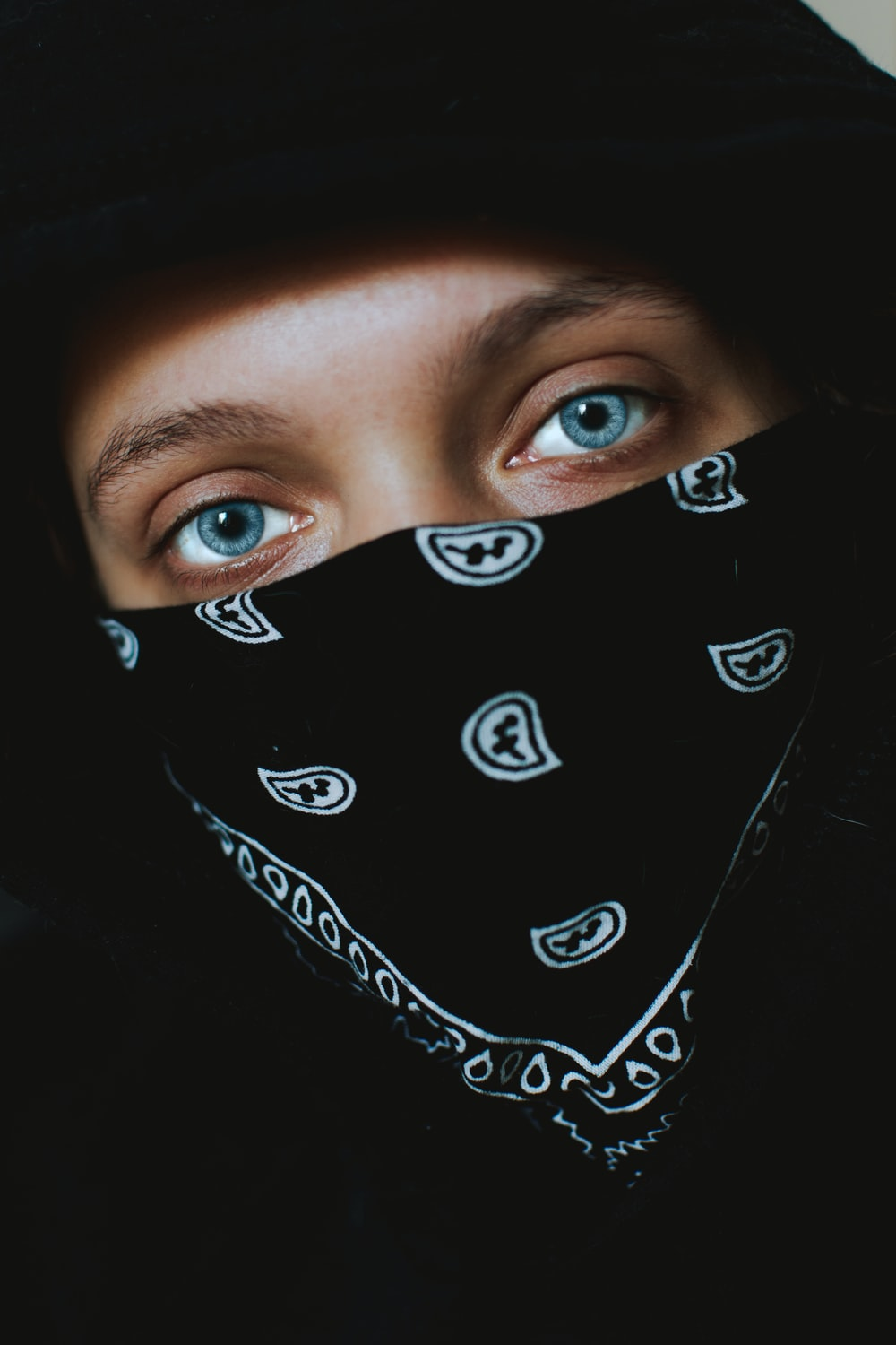 person in black and white paisley bandana