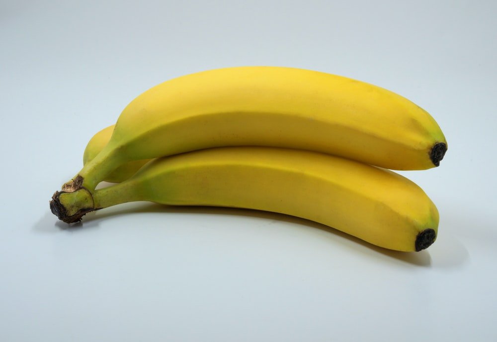 three banana fruits on white background