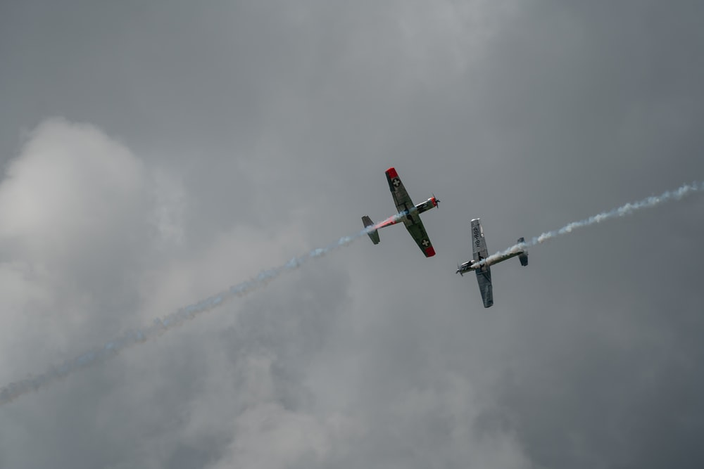 two gray planes under white clouds