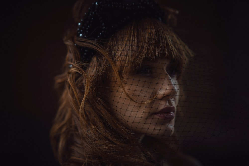 woman wearing black mesh veil