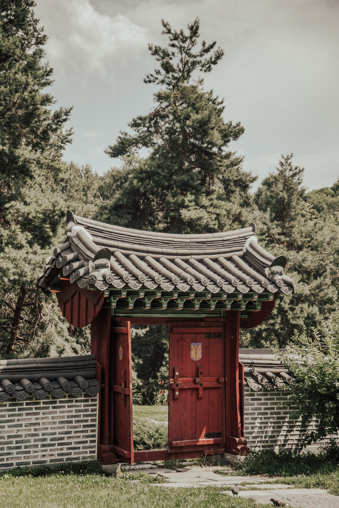 Korean Gate which is traditional Korean gate with a taegeuk mark (a yin-yang symbol)  2019, Korean Traditional Garden in Kiev