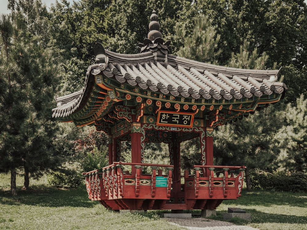 red and gray wooden shed with Hangul sign