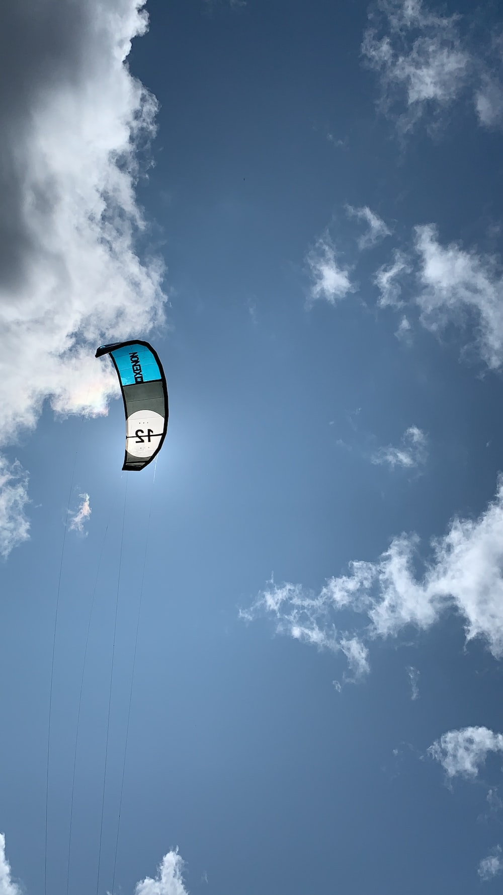 low angle photo of parachute during daytime