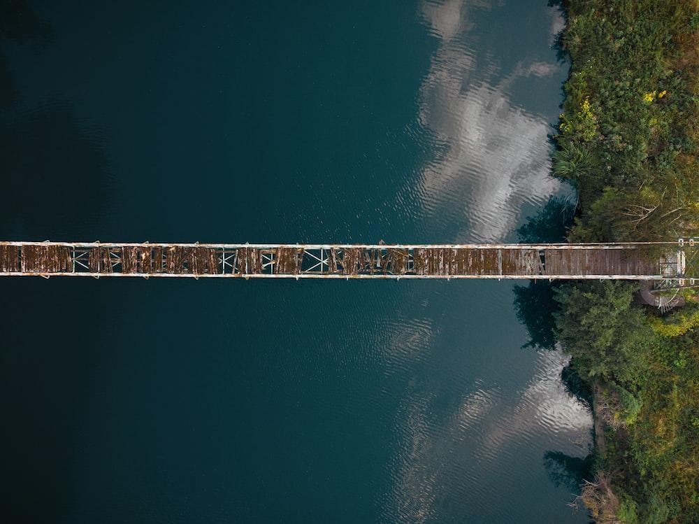 aerial view of broken hanging bridge