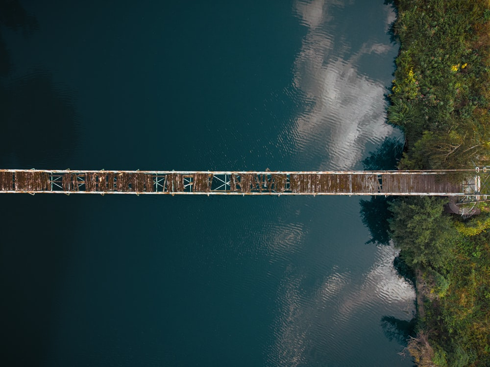 aerial view of broken hanging bridge