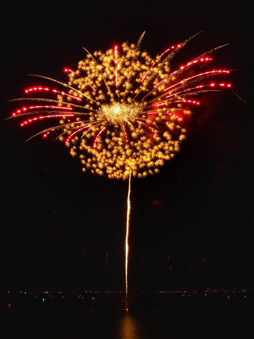 long-exposure photography of yellow and red fireworks