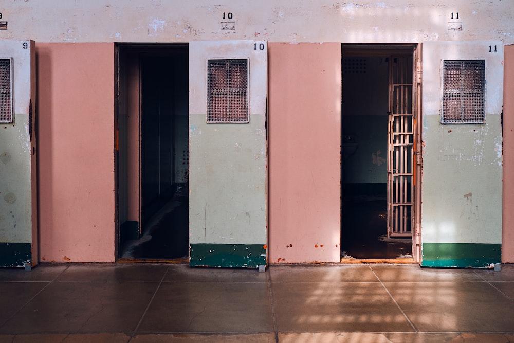 beige painted building showing open door