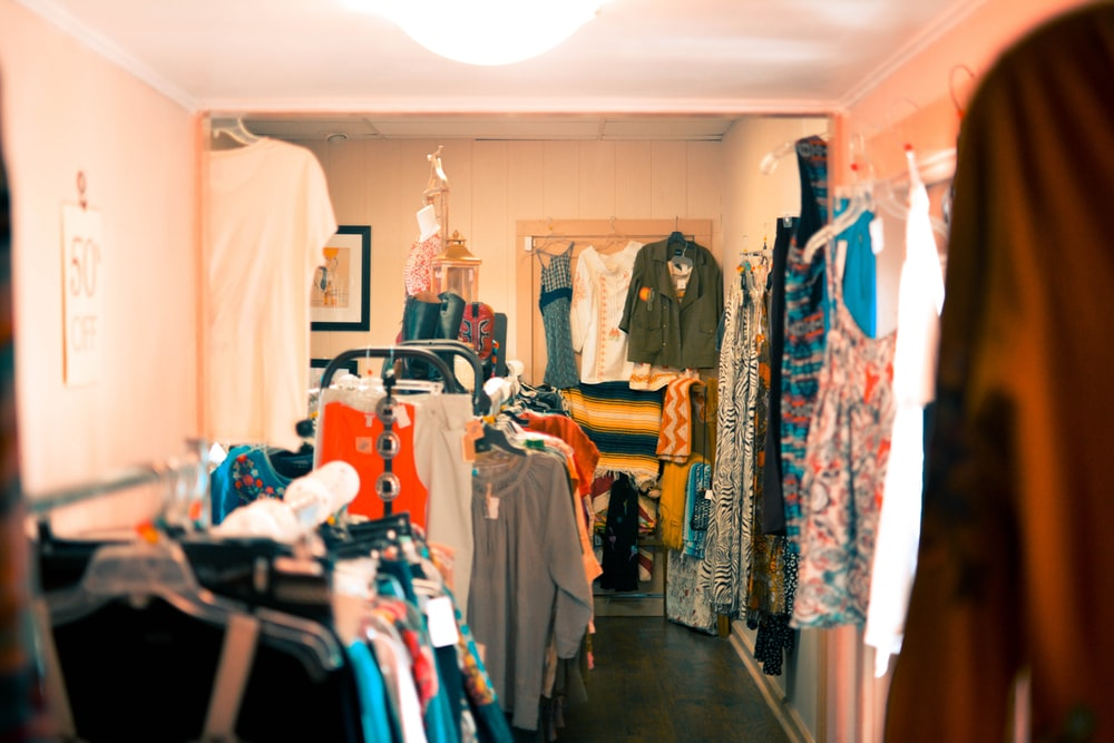 assorted-colored apparel in wardrobe