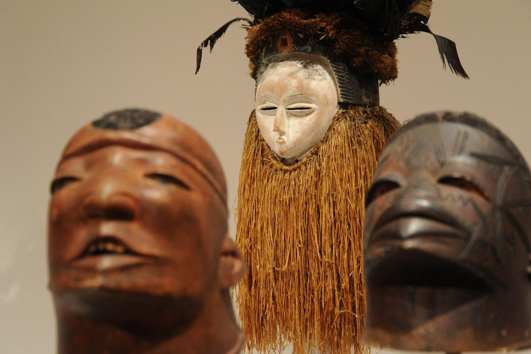 Expressive African masks, wood, grass, feathers, flowers, Seattle Art Museum, Seattle, Washington, USA