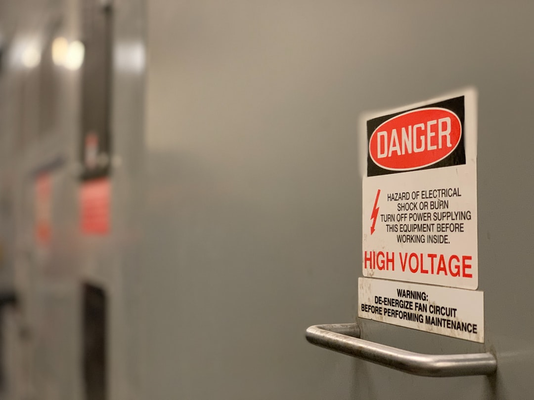 Danger High Voltage Sign on Electrical Switchgear Equipment