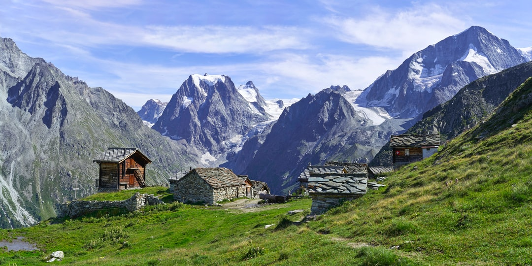 """Remointse de Pragra is an """"alpage"""" where cows spend the summer season. It is located at an altitude of 2'500 meters. From here the view is stunning : we can see the Pigne d'Arolla, the Mont Collon and many glaciers."""