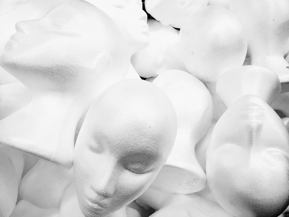pile of white mannequin heads