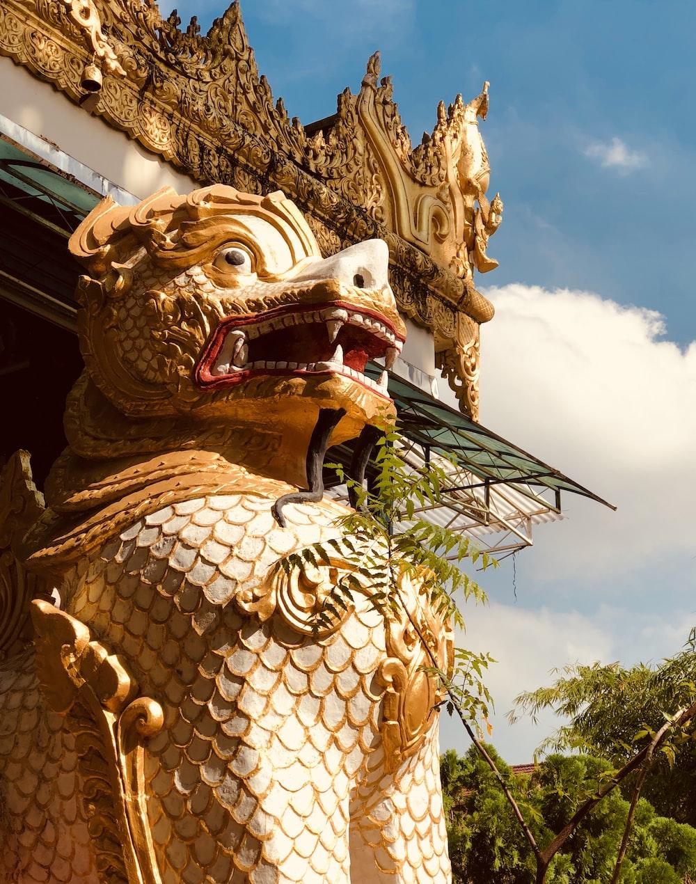 brown fu dog statue