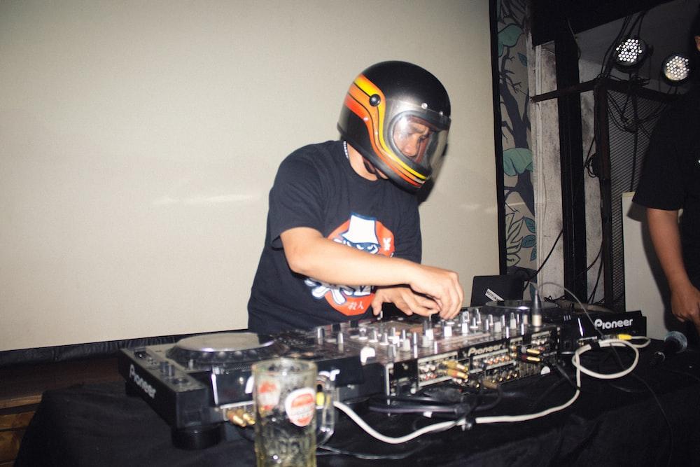 man playing DJ controller
