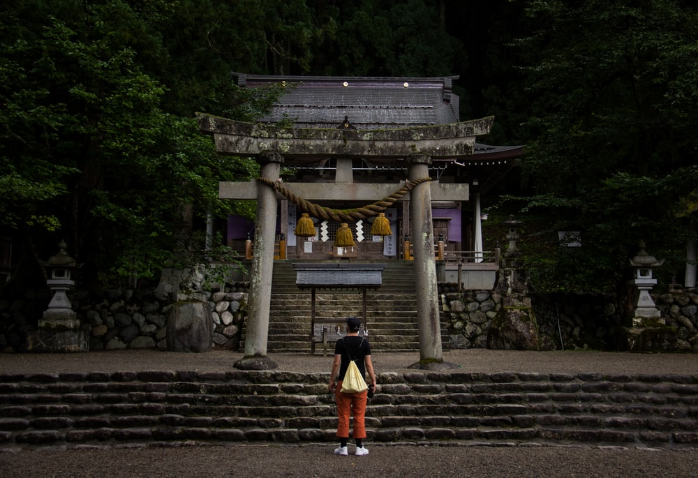man standing near temple