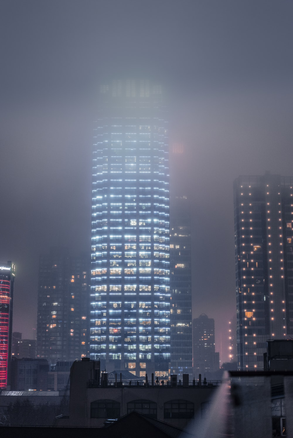 lighted high rise buildings at night